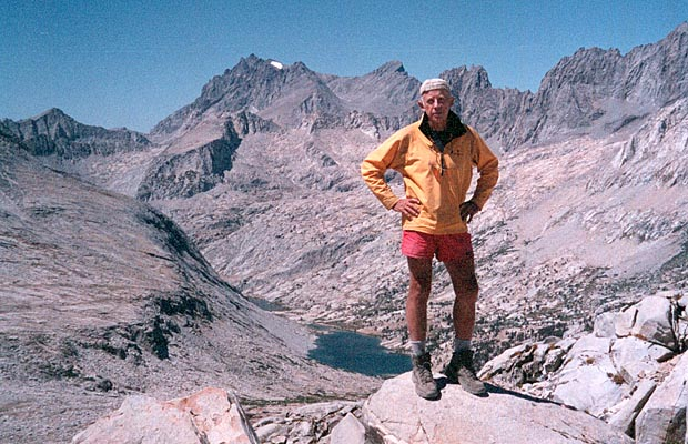Peter standing on Mather Pass ... the 14,000' plus peaks of the Palisades behind