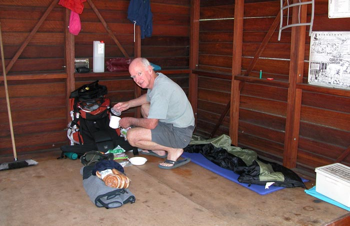 Mal ratting in his pack, crouched in his corner of the shelter situated on the Nullaki Peninsula