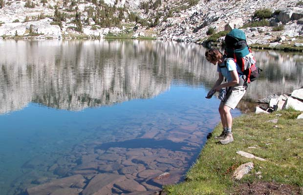 Lucy admiring the crystal clear waters of Heart Lake, below Selden Pass