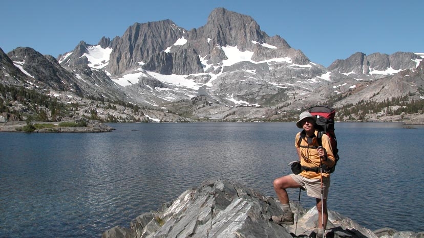 Peter standing above Garnet Lake with Ritter and Banner Peaks behind