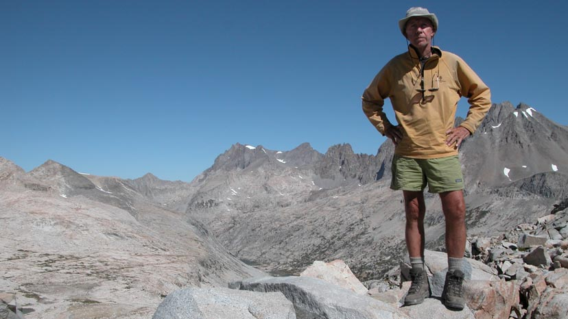 Peter standing on the summit of Mather Pass.  The Palisades behind.