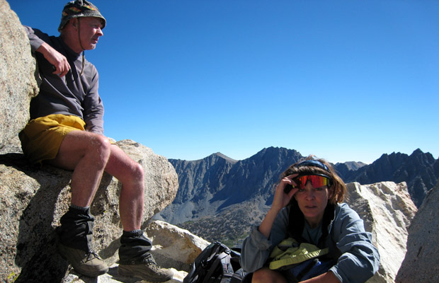 Mal and Lucy resting on the summit rocks of Mount Goode, 13,100'