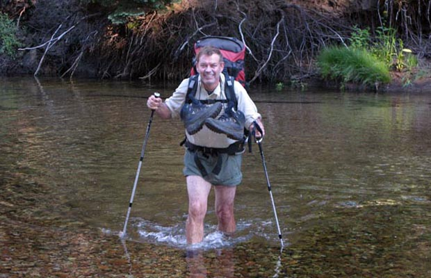 Jim K. wading Stubblefield Creek in the early morning after breaking camp.