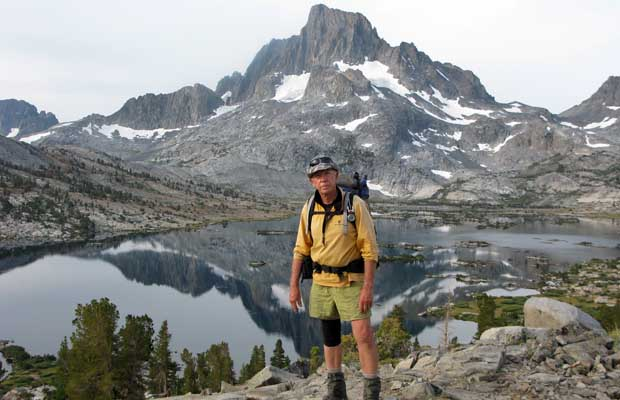 Peter standing on the Trail overlooking Thousand Island Lake with Banner Peak above.