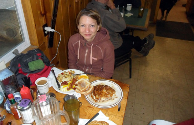 Yvonne dealing with a simple, small breakfast at Vermilion Resort