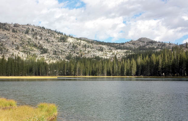 Looking back over Wilma Lake to where the PCT runs south from Jack Main Canyon.