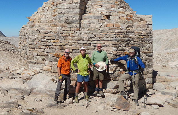 Bob, Peter, Mike and Ben standing by the Muir Hut, on Muir Pass [12,000']