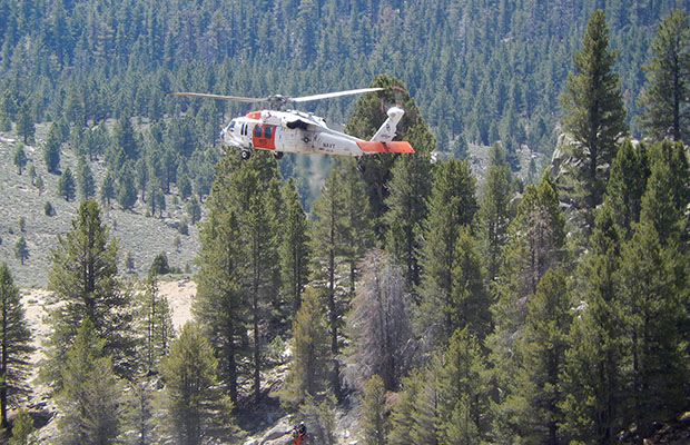 Practice rescue operation by the US Navy at the PCT Kern South Fork bridge.