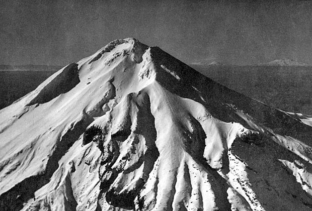 A late 1930's aerial photo of Mt. Egmont, looking east toward Mt. Ruapehu