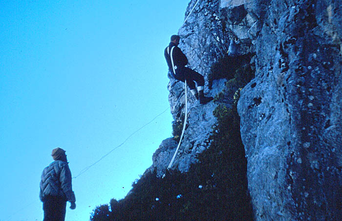 Tasman Glacier 1959: Rappelling the old fashioned way - no harness, no fancy descenders.