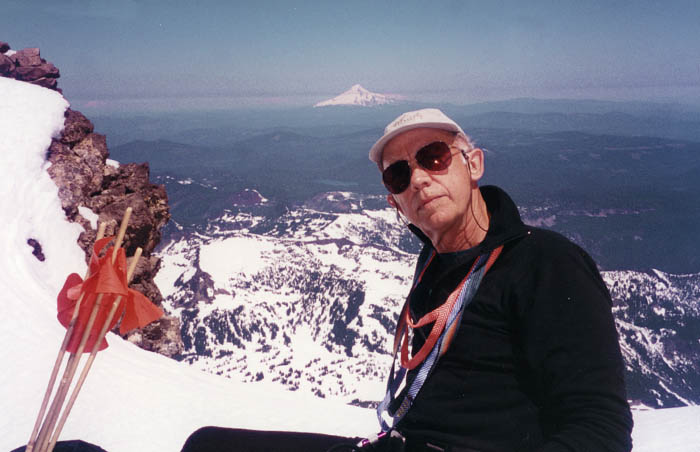1997: Peter resting at our high point for the climb - Mount Hood in the backgound