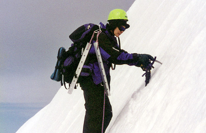 1997: Lucy leading the belayed traverse across, and up to the summit pinnacle