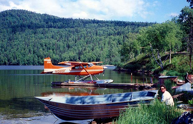 Randy and a Hudson Air floatplane [Cessna 185] on the lake near Talkeetna