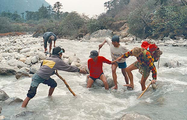 Crossing a flooded Hinku Khola without the use of a bridge!