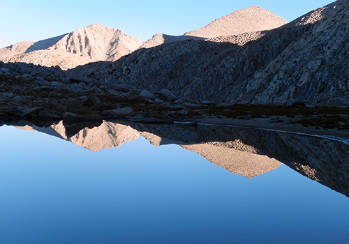 Early morning reflection on the Tarn by our campsite.