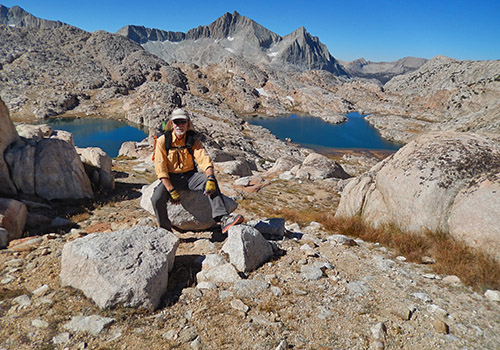 Bob relaxing after our climb.  Ursa and Big Bear Lakes below.