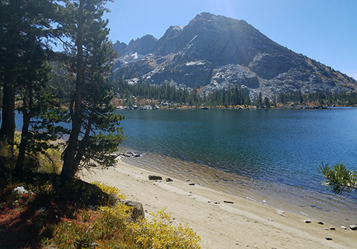 A PCT beach along Dorothy Lake. Forsyth Peak in background.