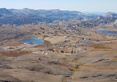 On Big Sam summit looking down to the lakes of Emigrant Wilderness.