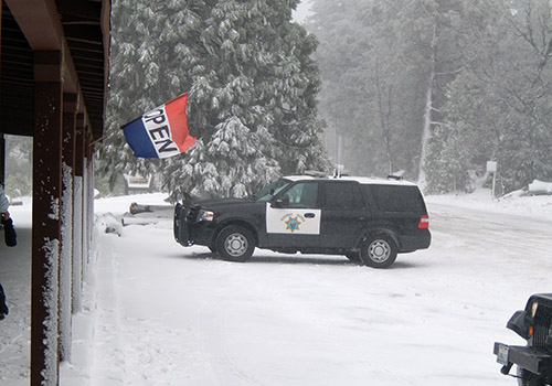 A Highway Patrol officer in the blizzard at the Laguna Lodge and Store