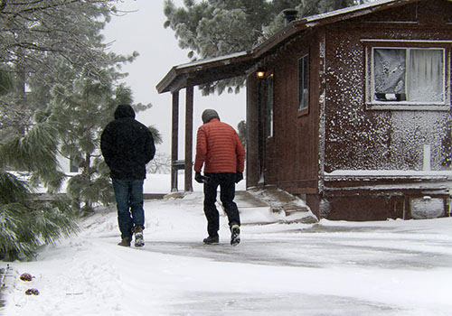 Mike and Randy battling the blizzard near our Laguna cabin.