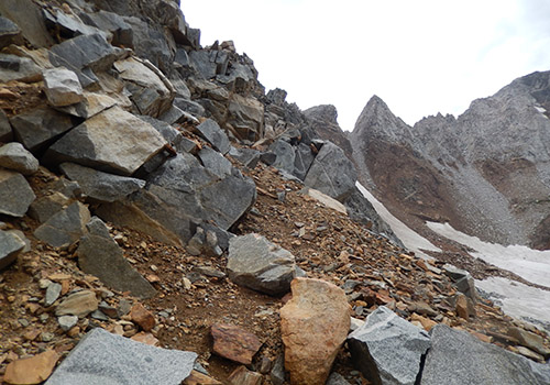 Near the top of Hopkins Pass [11,400'] - a narrow ledge of fractured rock.