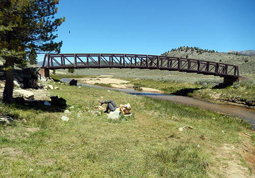 The PCT bridge over the River Kern.  Bob relaxing in the grass.