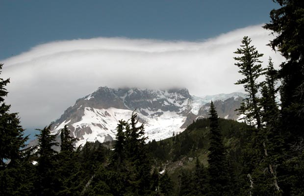 A lenticular cloud enveloping Sunset Ridge on the northwest face of Mt. Rainier