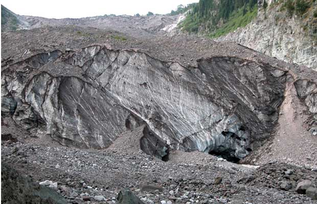 The icy snout of Carbon Glacier at an elevation of only 3,600'.