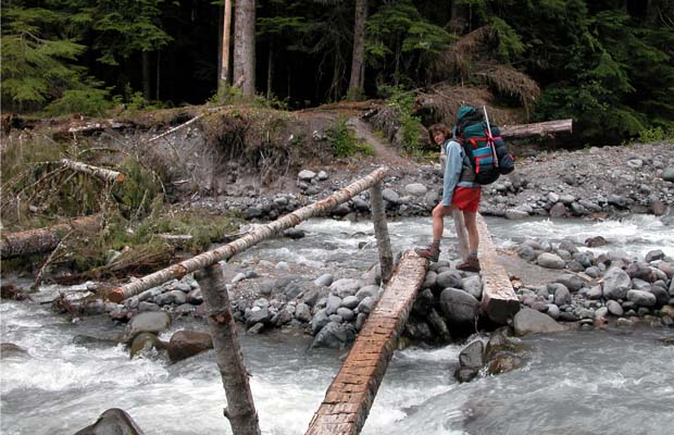 Lucy crossing one of the safer sections of the glacier fed Mowich River.