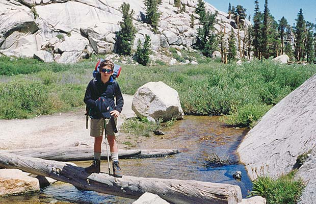 August 1993: Jordan crossing the creek near Outpost Camp.